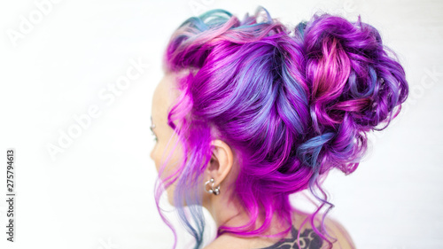 Wedding hairstyle of curls for a modern and unusual bride. Portrait of a young stylish woman with bright colored hair.