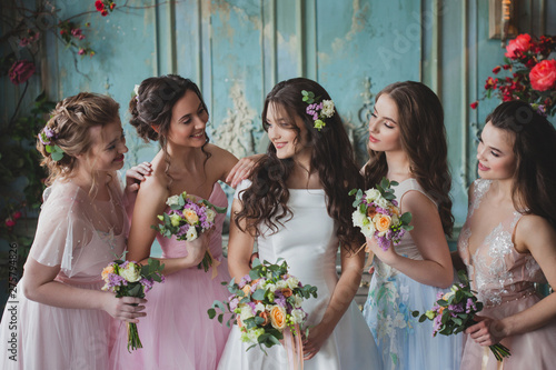 Canvas Beautiful young woman bride with friends. A wedding celebration