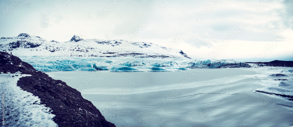 Fototapety, obrazy: Huge majestic glacier's icy surface by snowy mountain in Iceland