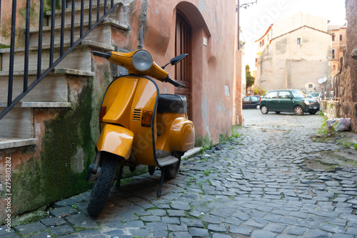 Scooter orange scooter in typical Italian street