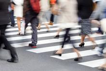 People Crossing A Street In Motion