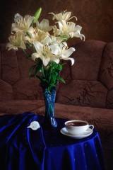 Fototapeta Do herbaciarni Still life with bouquet of white lily in interior