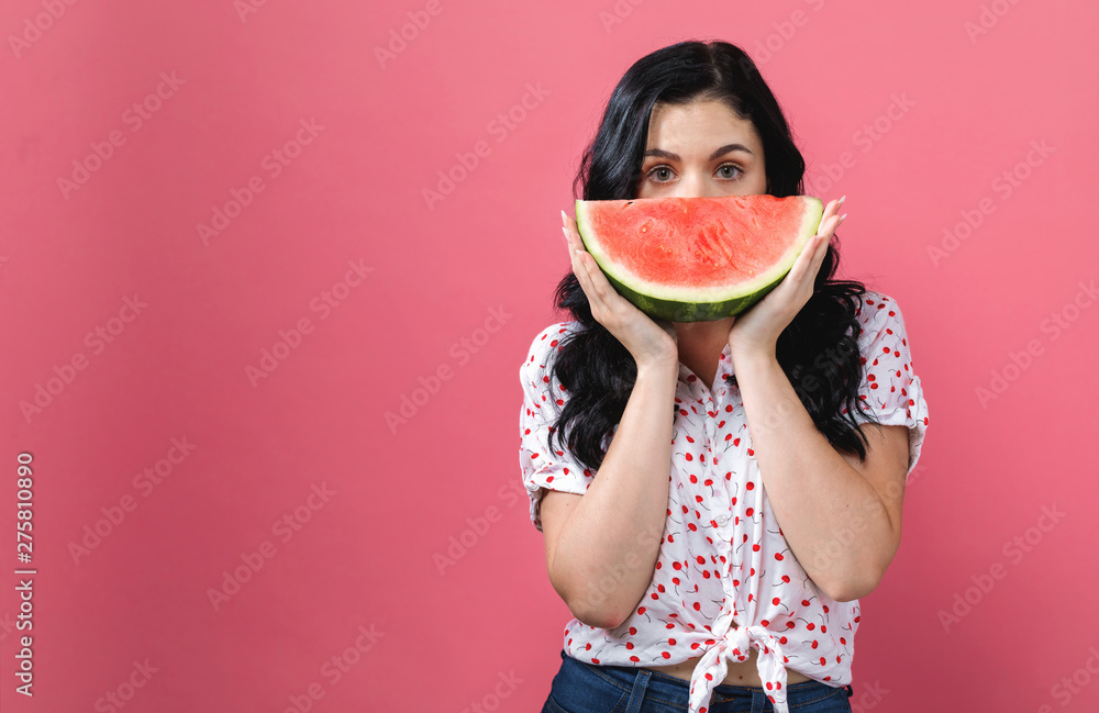 Fototapety, obrazy: Young woman holding watermelon on a solid background