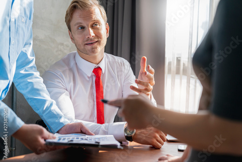 Fototapeta successful business meeting caucasian businessman manager white shirt red tie enjoy with result of profit from chart graph with co worker office background obraz