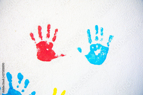 Obraz na plátně  Colorful hand prints of hands isolated on white wall background