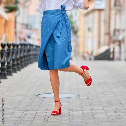 Obraz na plátně Female legs and jeans wrap skirt