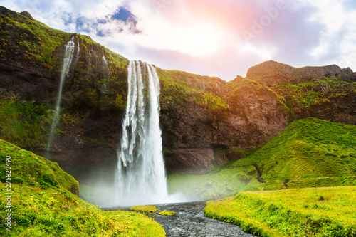 Obraz na plátně Seljalandsfoss waterfall in Iceland at sunset