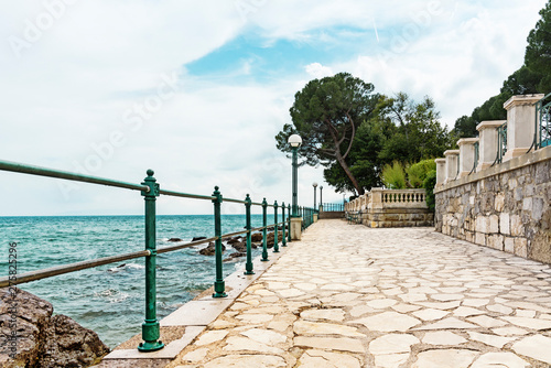 boulevard with fence and pavement along the Adriatic Sea,  Opatija, Croatia Fototapeta