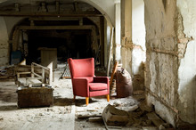 Red Comfort Chair In A Destroyed House Full Of Demolition Waste