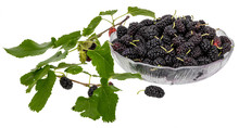 A Bowl Full Of Black Mulberries Decorated With Mulberry Leaves And Unripe Fruits