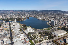 Aerial View Of Lake Merritt Park And Downtown Buildings And Streets In Oakland California.
