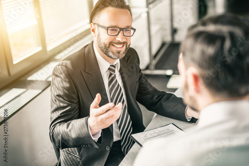 Business people negotiating a contract. - 275848206
