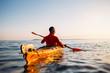 Rear view of senior man enjoy paddling kayak