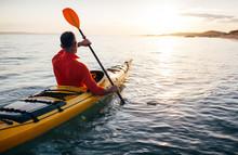 Senior Man Paddling Kayak On T...