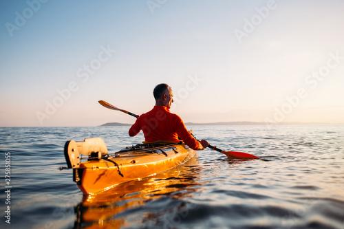 Fényképezés  Rear view of senior man enjoy paddling kayak