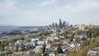 Cinematic Aerial View of Seattle Downtown from Suburbia With Waterfront City Road Traffic and Skyscrapers in Horizon