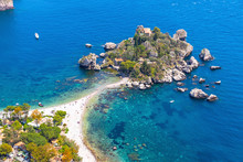 Aerial View Of Isola Bella Island And Beach In Taormina, Sicily, Italy. Giardini-Naxos Bay, Ionian Sea Coast. Isola Bella (Sicilian: Isula Bedda) Also Known As The Pearl Of The Ionian Sea