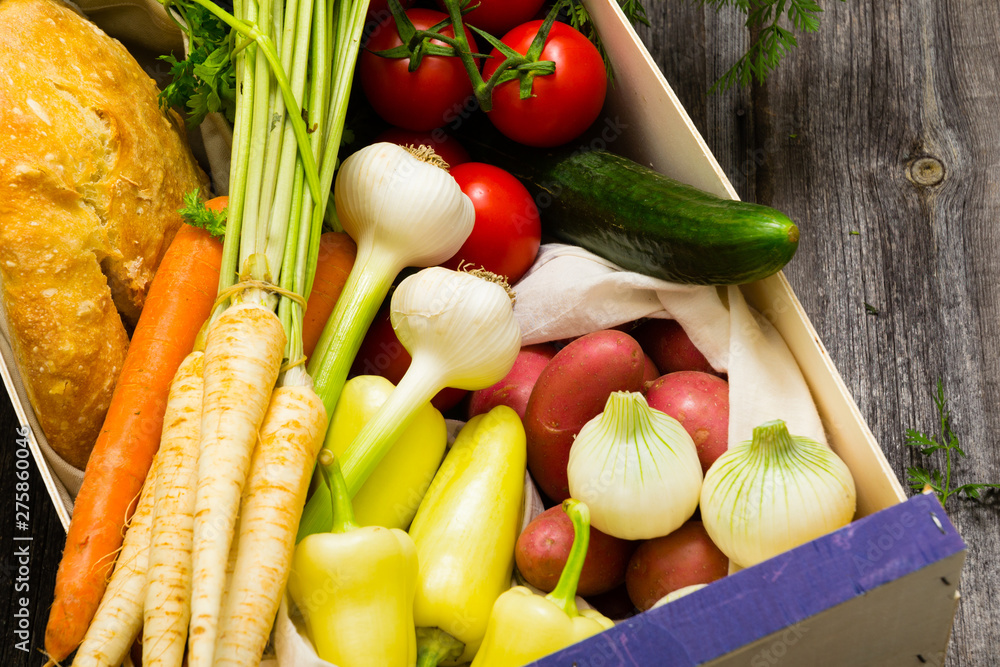Fototapety, obrazy: vegetables and a loaf of bread at wooden crate, top view
