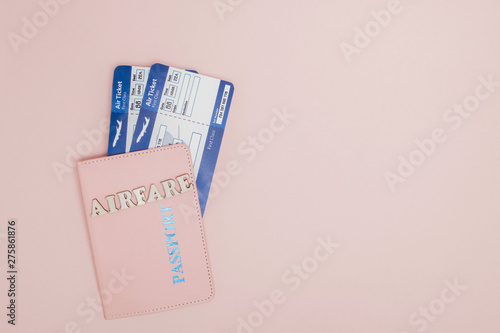 Inscription airfare , Airplane, air ticket and money on a pink background Wallpaper Mural