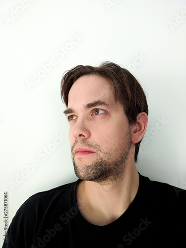 Portrait of Ambivalent Young Man Isolated on White Background Canvas Print