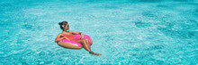 Vacation Beach Banner Woman Relaxing On Donut Inflatable Float Ring Swimming In Turquoise Ocean Water Panoramic. Summer Travel Sun Lifestyle.