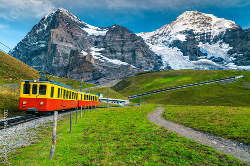 Electric tourist train and snowy Eiger mountain, Bernese Oberland, Switzerland - 275887832