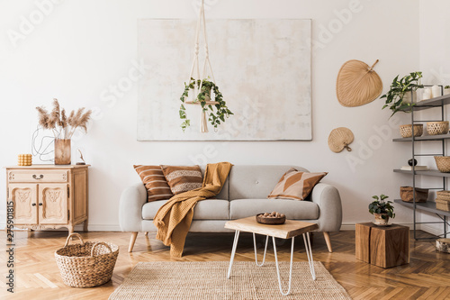 Keuken foto achterwand Bloemenwinkel The stylish boho compostion at living room interior with design gray sofa, wooden coffee table, commode and elegant personal accessories. Honey yellow pillow and plaid. Cozy apartment. Home decor