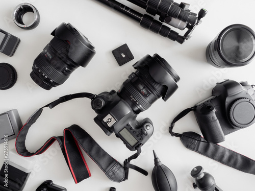 top view of work space photographer with digital camera, flash, cleaning kit, me Canvas Print