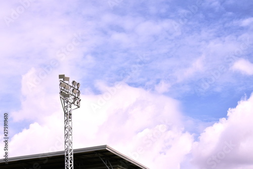 Obraz na plátne football stadium lamp structure on blue sky background in sunny day
