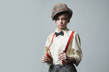 Funky Beauty. Vintage English Style. Suspender And Bow Tie. Old Fashioned Child In Checkered Beret. Jazz Step Fashion. Retro Fashion Model. Vintage Charleston Party. Teen Girl In Retro Male Suit