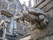 Terrible Gargoyle On The Facade Of A Medieval Castle