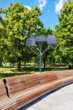Benches And Solar Panels In Park