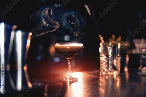 Cuadros en Lienzo  elegant glass with espresso martini cocktail on blue background