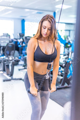 Beautiful blonde woman practicing a fitness lifestyle , training in the gym