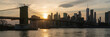 Banner and cover scene of New york Cityscape with Brooklyn Bridge over the east river at the sunset time, USA downtown skyline, Architecture and transportation concept