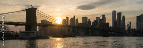 Poster New York Banner and cover scene of New york Cityscape with Brooklyn Bridge over the east river at the sunset time, USA downtown skyline, Architecture and transportation concept