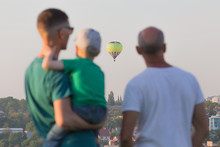 People Watching The Hot Air Balloons