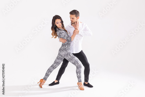 Social dance concept - Active happy adults dancing bachata or salsa together ove Fototapete