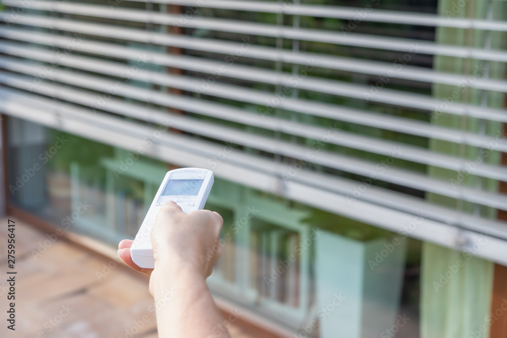 Fototapety, obrazy: Control the external window blinds with the remote control. Vertically.