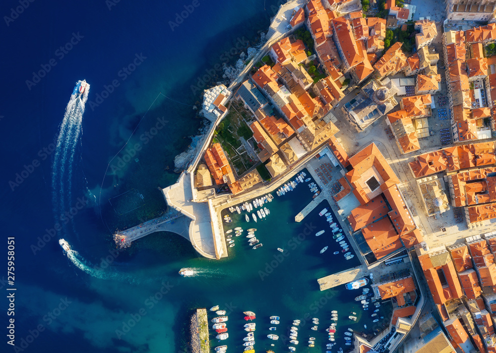 Fototapeta Dudrovnik, Croatia. Aerial view on the old town. Vacation and adventure. Town and sea. Top view from drone at on the old castle and azure sea. Travel - image