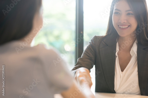 Portrait young Asian woman interviewer and interviewee shaking hands for a job interview Wallpaper Mural