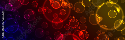 Foto  Glowing colorful bubbles on a dark background