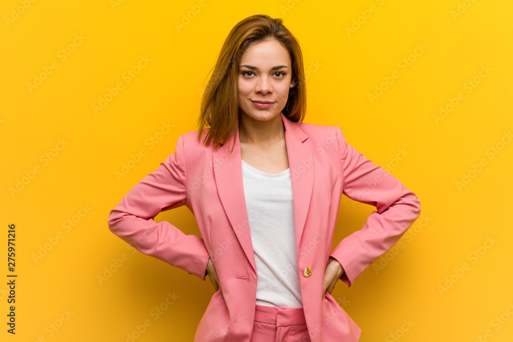 Fototapeta Young fashion business woman confident keeping hands on her hips.