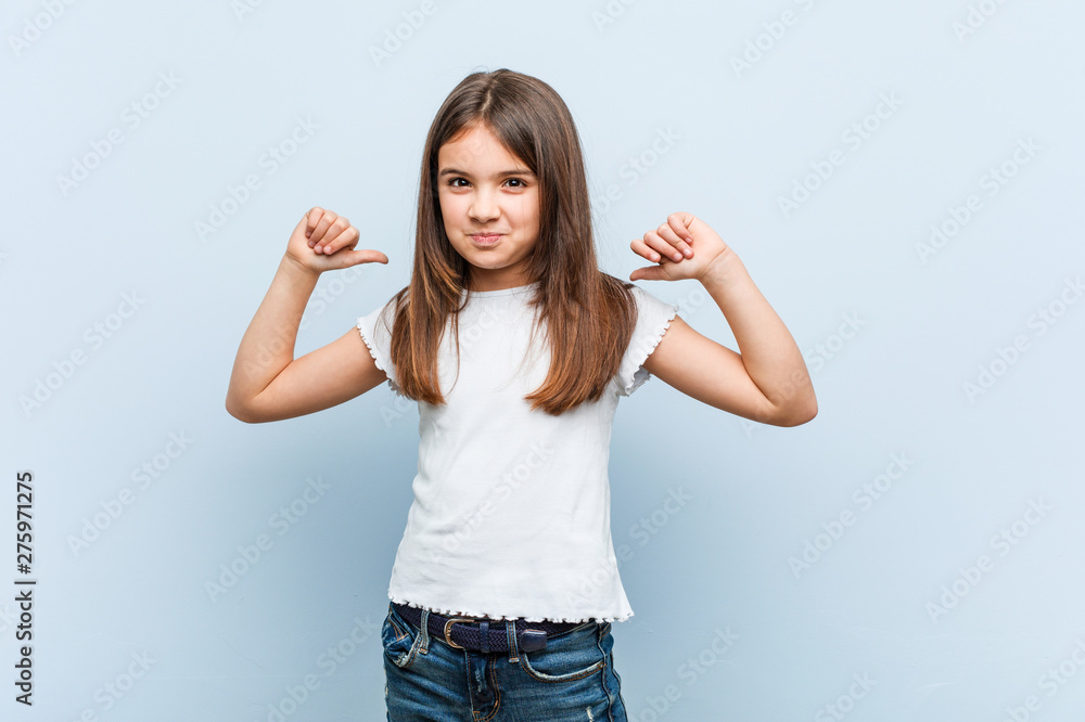 Fototapeta Cute girl feels proud and self confident, example to follow.