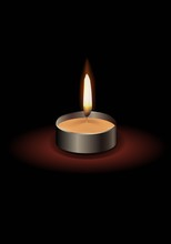Small Candle With A Flame With...