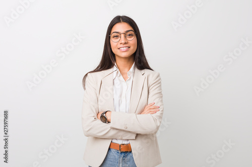 Fényképezés  Young business arab woman isolated against a white background who feels confident, crossing arms with determination