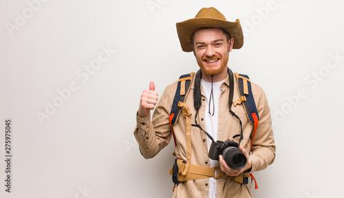 Young redhead explorer man smiling and raising thumb up Fototapeta