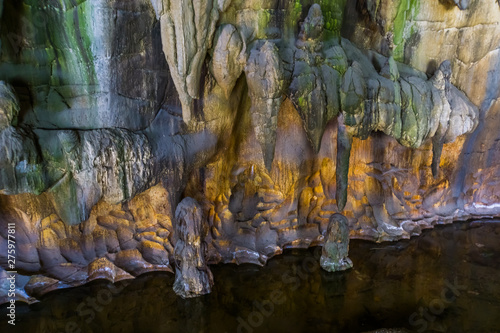 Fantastique Paysage beautiful scenery in a drip cave, stalagmite stones and water, underground grotto background