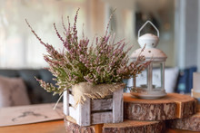 Basket With Heather On The Table.heather In A Basket . Autumn Decorations.pink And Purple Flowers Heather,heath In Wooden Box,autumn Plants And Lantern.country House. Seasonal Decorations