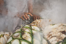 Hands Roasting Agave